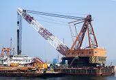 A Crane Operates To Build The Bridge To Macau And Zhuhai
