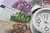 Euro Notes And Clock. Business Concept.