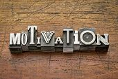 motivation  word in mixed vintage metal type printing blocks over grunge wood