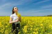 woman with yellow flowers on the field