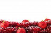 Red Christmas balls lying on tinsel