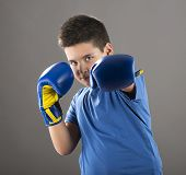 Child ready to swing left hook