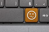 Confused. Orange Hot Key Emoticon On Computer Keyboard.