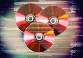 Collection of cd discs on red digital background