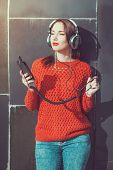Beautiful Hipster Girl Listening Music