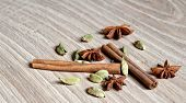 picture of cardamom  - star anise cinnamon stick and cardamom on a wooden background - JPG