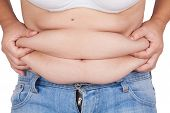 stock photo of flabby  - abdominal surface of fat woman on white background - JPG