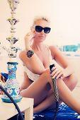 image of hookah  - Woman with hookah on the beach in bikini - JPG