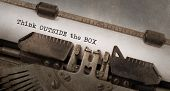 stock photo of thinking outside box  - Vintage typewriter old rusty and used Think outside the box - JPG