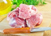 foto of raw chicken sausage  - raw meat and knife on the kitchen table - JPG