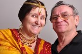 image of sari  - portrait of happy senior couple husband and wife wearing Indian clothing sari tikka and necklace - JPG