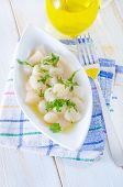 stock photo of scallops  - scallop with oil on the plate and on a table - JPG