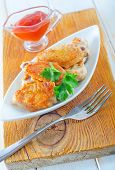 stock photo of chicken wings  - fried chicken wings on white plate and on a table - JPG