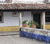 image of humble  - A humble little house in Obidos Portugal - JPG
