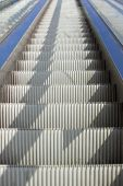foto of escalator  - Empty steel escalator with nobody looking up - JPG