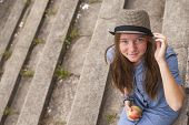 pic of stepping stones  - Young girl sitting on the stone steps of the old park - JPG