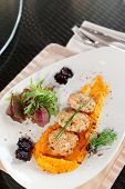 foto of patty-cake  - White meat patty cakes with pumpkin mash on restaurant table - JPG