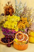 stock photo of tansy  - Medicinal herbs with honey calendula oats immortelle flower tansy herb wild rose dried lemon - JPG