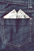 foto of std  - Two condoms in the blue jeans pocket - JPG