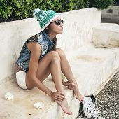 foto of vest  - fashion young woman in sunglasses and handmade denim vest relaxing on a sunny day  - JPG
