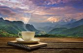picture of morning  - Morning cup of coffee with mountain background at sunrise - JPG