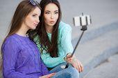 image of two women taking cell phone  - Beautiful girls - JPG