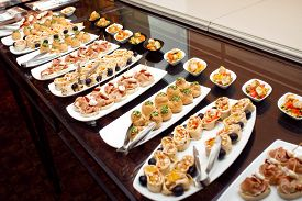 stock photo of continental food  - Buffet meal at a hotel continental breakfast - JPG