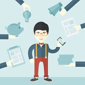 foto of tasks  - A japanese Man with smartphone in hand has a lot of of task and paperwork suitable for time management business concept - JPG