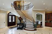 pic of entryway  - Foyer in luxury home with circular staircase - JPG