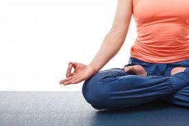 stock photo of ashtanga vinyasa yoga  - Close up of of yogini woman in yoga asana Padmasana  - JPG