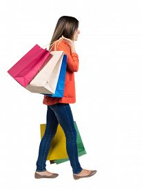 pic of heavy bag  - back view of going  woman  with shopping bags  - JPG