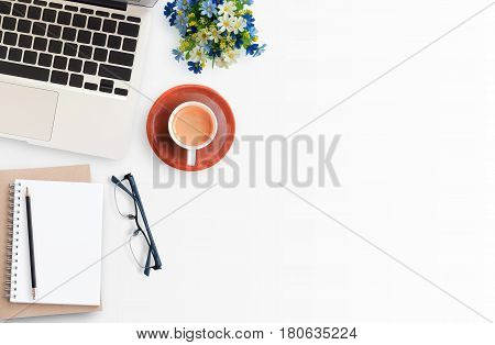 poster of Modern White office workspace with eye glasseslaptop computerpencil and cup of coffee. Top view with copy space.Office supplies and gadgets on workspace.Working desk table concept.