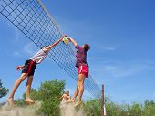 Three Men Playing Beach Volleyball - Teenager In T-Shirt Block The Tall Guy'S Strike