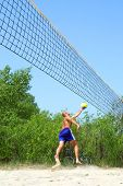 Playing Beach Volleyball - Balding Man Falls Trying To Catch The Ball