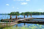 Six Kids Run Through Bridge To Jump Into Morning River