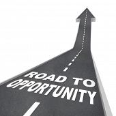 The words Road to Opportunity in white letters on a street leading to an arrow symbolizing change, s