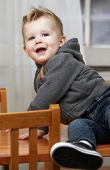 Playful Toddler On Table