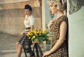 Fashion style photo of a gorgeous women wearing retro clothes