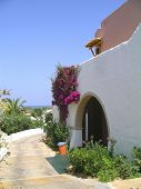 Beautiful front entrance of a stone house facing the sea in bright sunshine