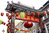 Red and yellow chinese lanterns decorating the entrance of Chinatown, London