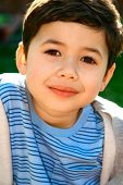 Beautiful boy from inter-marriage couple, enjoying the sunny outdoors.