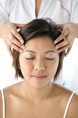 pic of radiation therapy  - Young Asian female receiving gentle head massage as part of holistic therapy treatment in spa lifestyle - JPG