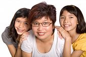 Happy Chinese mother with her two beautiful daughter.l