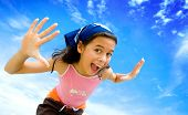Young girl happy in swimming costume with beautiful blue sky in background