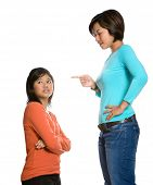 Asian woman telling off her younger sister.