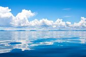 stock photo of cumulus-clouds  - Beautiful cumulus clouds in the horizon above tropical islands in the sea - JPG