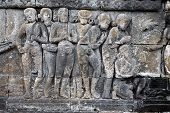 Relief carved stone of ancient Buddhist cosmology at the Borobudur temple, Jogjakarta, Indonesia. poster