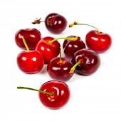 Bunch of red cherries on white