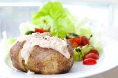 Baked jacket potato with tuna and fresh salad