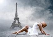 Woman dancer seating posing on the Eifel tower background poster